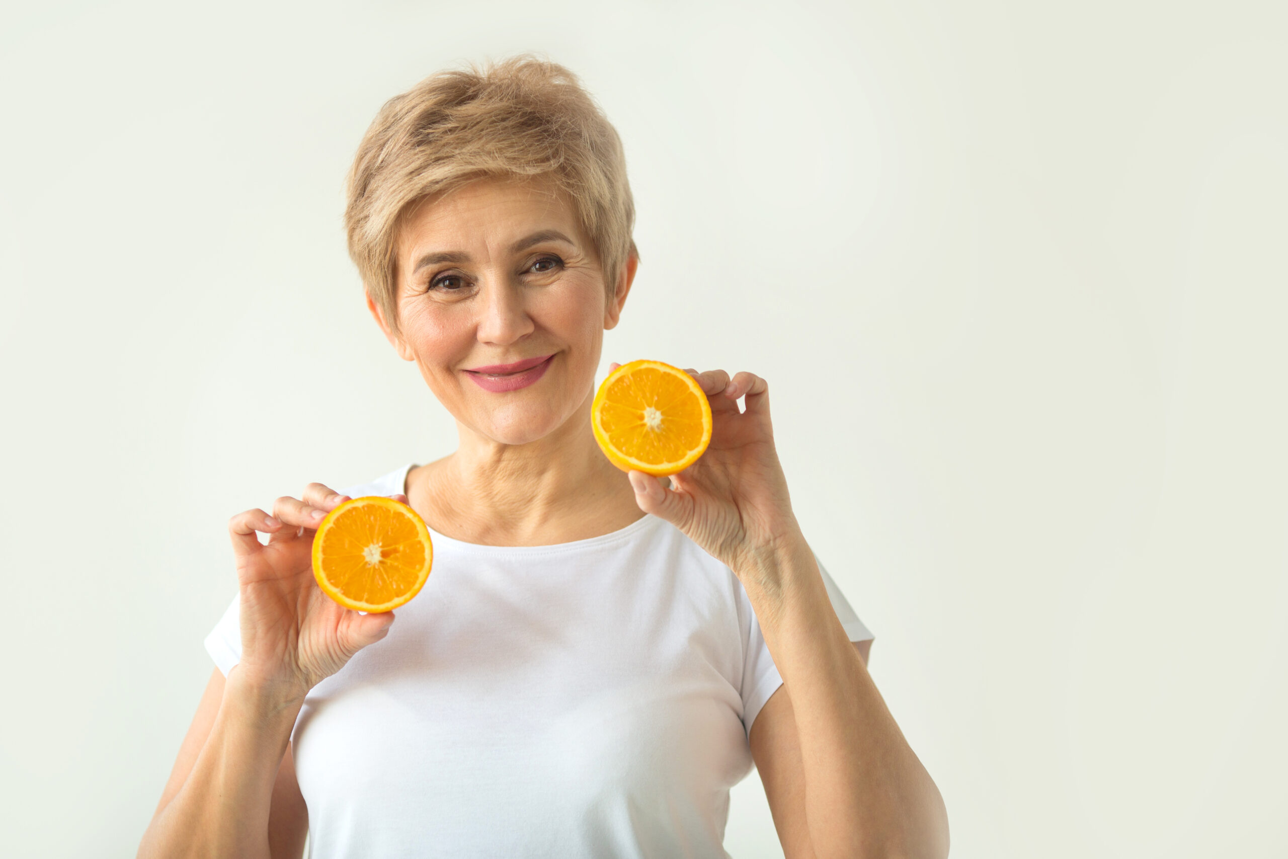 Beautiful,Aged,Woman,With,A,Short,Haircut,In,A,White