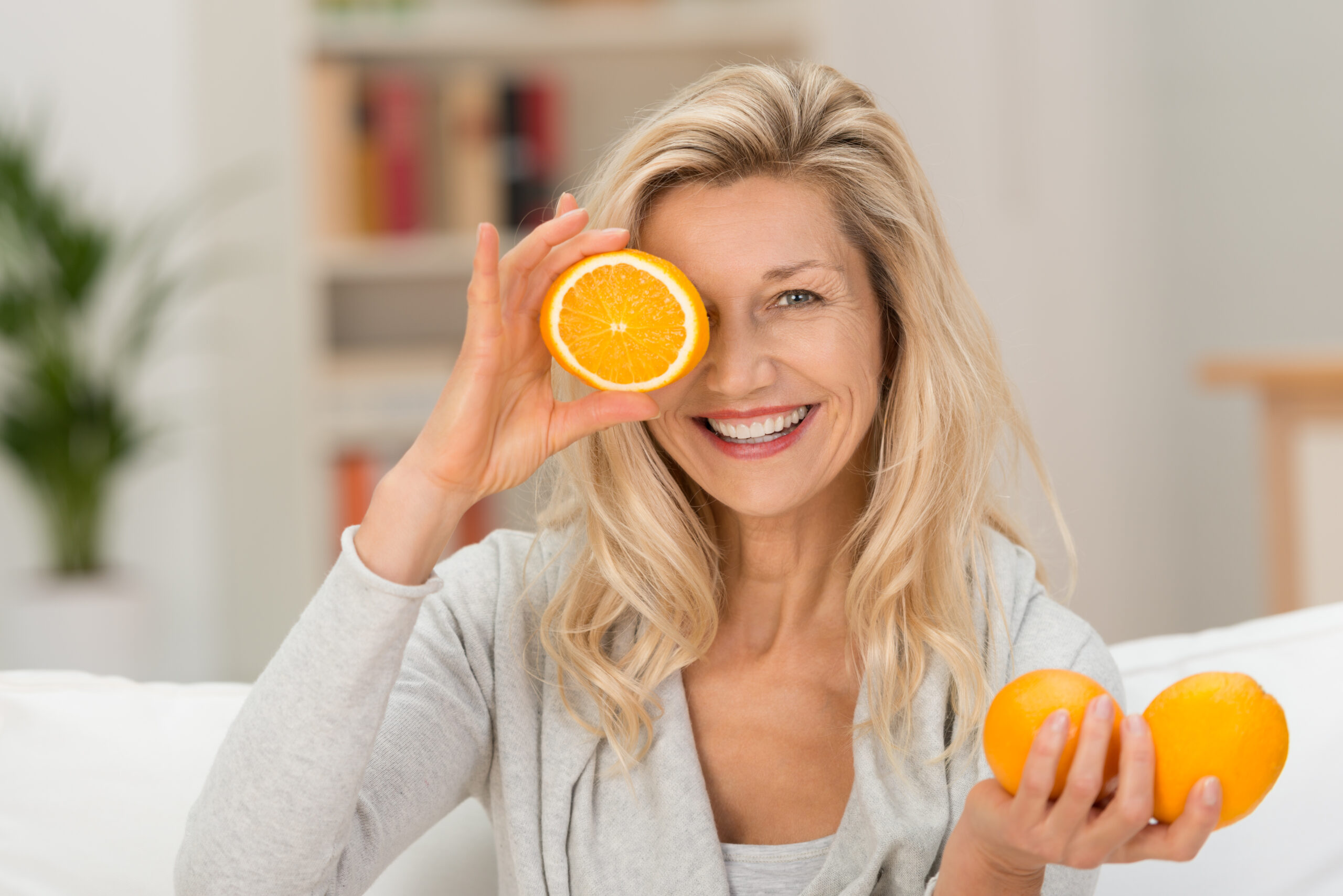 Happy,Healthy,Woman,Playing,With,Fresh,Ripe,Oranges,Holding,Two
