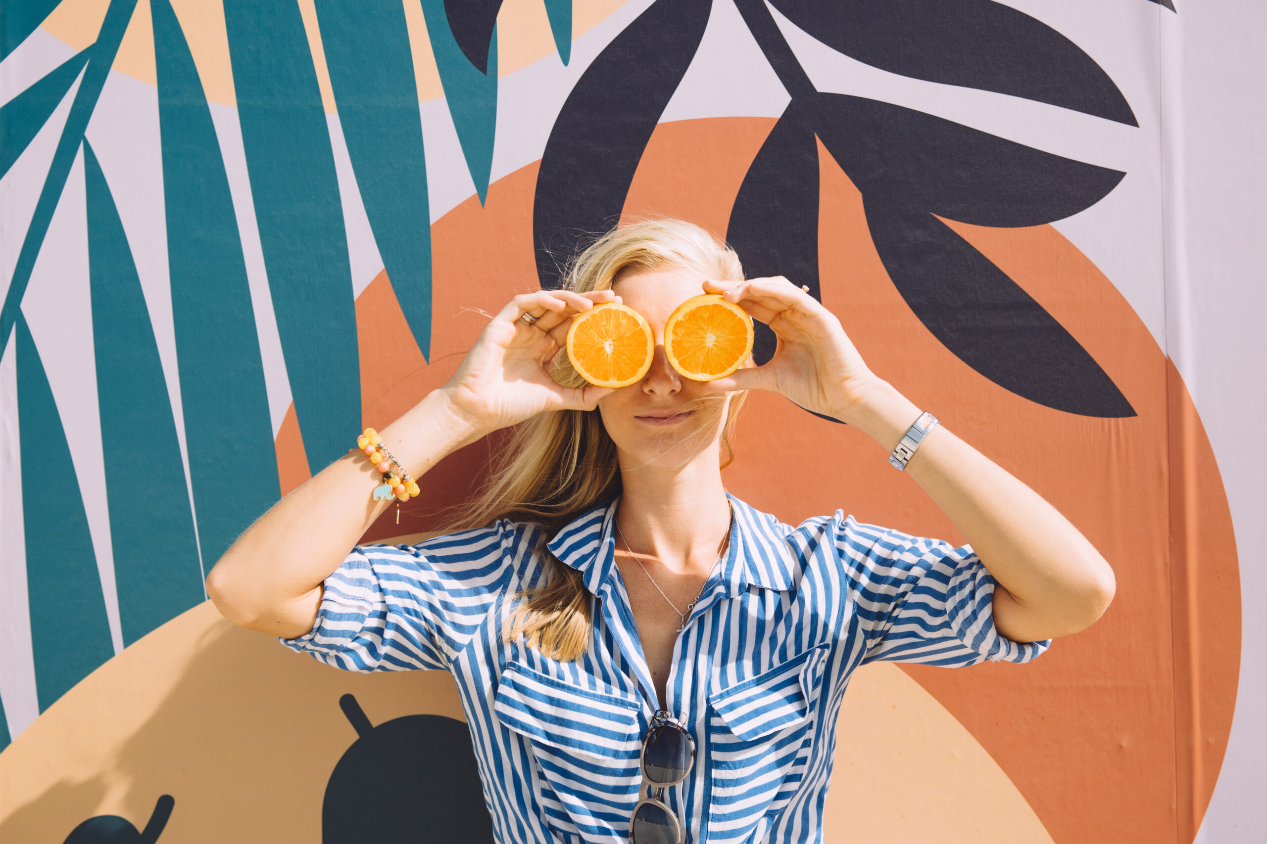 Young,Pretty,Woman,Holding,Oranges,In,Front,Of,Her,Eyes